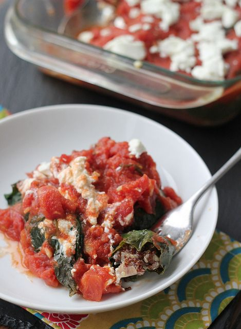 Quinoa and walnut stuffed collard rolls with tomatoes and goat cheese
