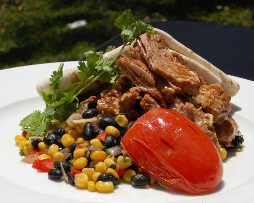 Cola Carnitas. Slow braised Ancho Chili glazed pork shoulder with corn ...
