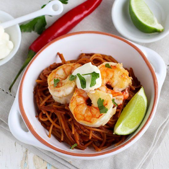 Spicy smoky noodles, topped with huge grilled tiger prawns, sweet and ...