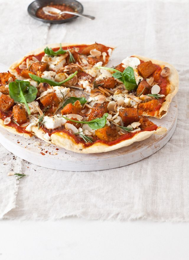 roasted pumpkin goat's cheese rosemary and tOasted almond pizza.