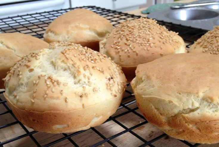 Sprinkle these gluten free hamburger buns with sesame seeds before ...