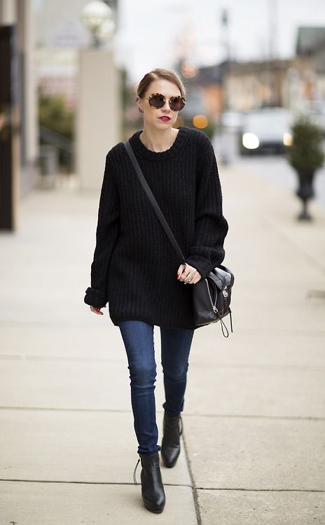 Black long sweater and blue jeans