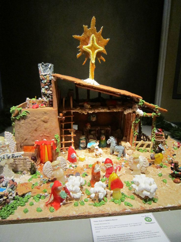 """Youth Division - """"Unto You a Child is Born."""" Materials used: pasta, sunflower seeds, sprinkles, shredded wheat, peanut brittle, cotton candy, cookies, Lifesavers, licorice, and melted hard candy,"""