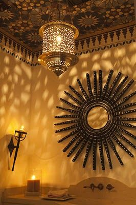 Moroccan style light, mirror and ceiling.