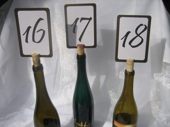 Wine cork table numbers. Empty bottles, depending on the bottle could put something in them.