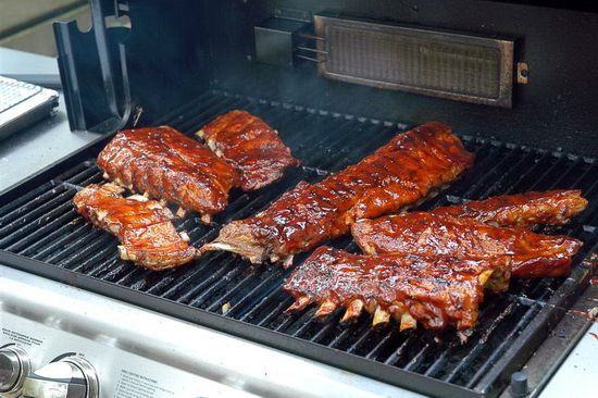 Bourbon Barbeque Ribs - one of my favorite things about the summer grilling season is enjoying tender ribs which are juicy, a little spicy and with an oh-so-delicious slightly sweet sticky homemade barbeque sauce slathered on in multiple layers. These ribs make the end of a beautiful summer afternoon simply perfect.