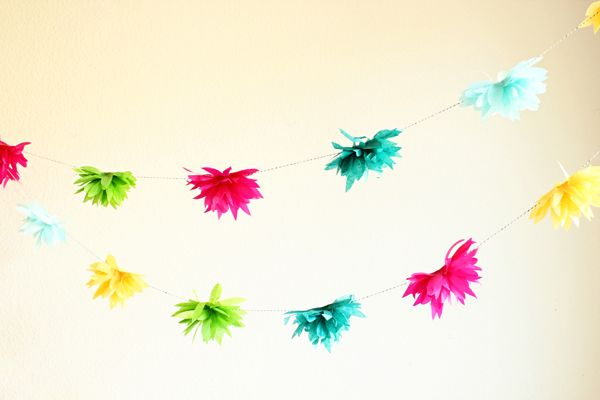 tissue flower garlands are my fave on http://www.youaremyfave.com