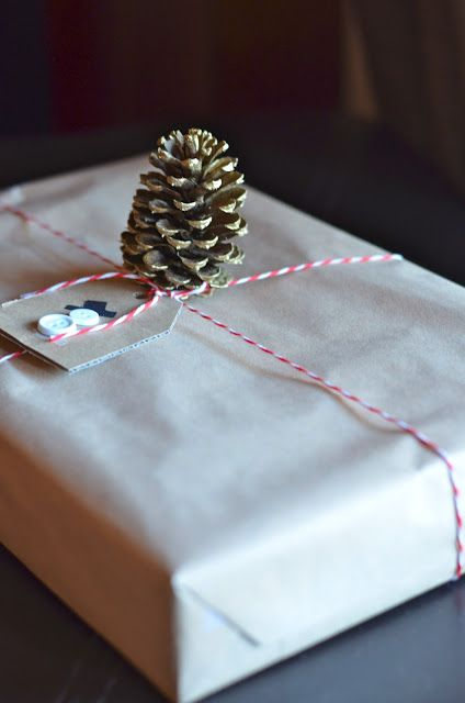 Simple brown paper wrapping with string and pinecones of course