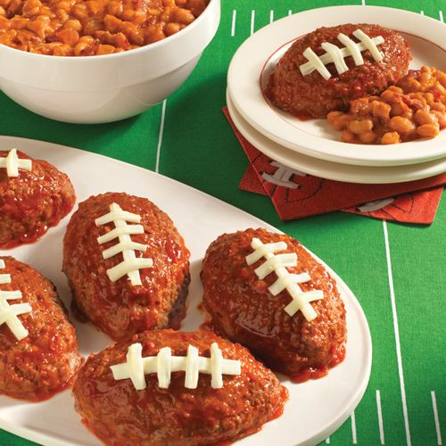 Delicious oval-shaped meatloaves glazed with rich ketchup before ...
