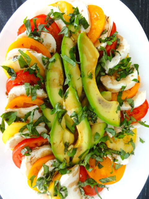 A new twist on Caprese Salad (with Avocado) via www.freshfoodperspectives.com