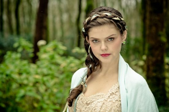 is beautifully braided hair; also weave ribbons through the plaits