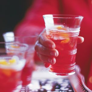 Campari and soda water, complete with a twist of orange, makes a ...