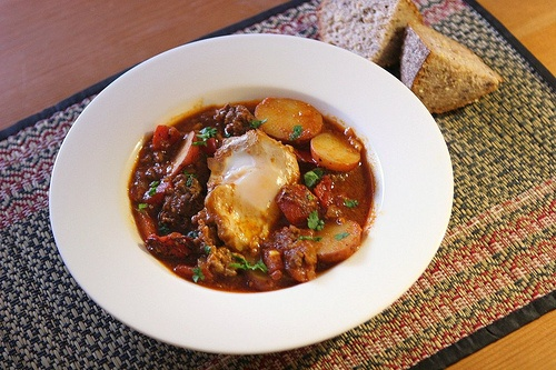 Moroccan ragout with poached eggs. Sausage and potatoes in a spicy ...