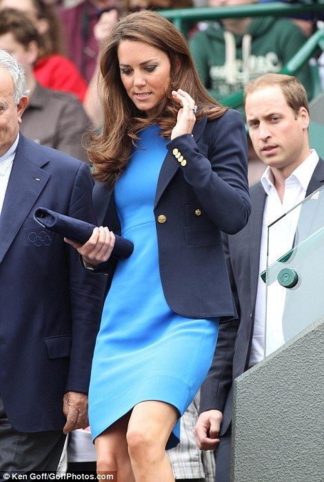 Kate looked effortlessly chic in a bright blue knee-length dress which she matched with her favourite navy blazer and a blue velvet clutch. August 2, 2012