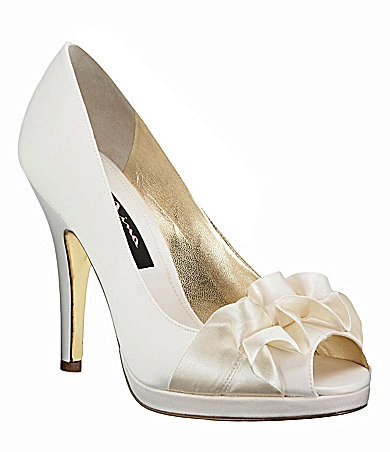 Ivory/white pumps. Dillard's