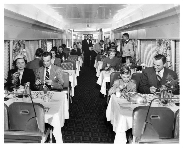 "Dinner aboard the ""Spirit of St. Louis"" train No. 50 eastbound, enroute from St. Louis to New York. This was a twin-unit dining car. 1953."