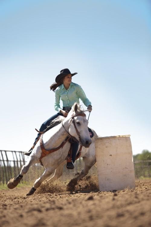 Barrel racing cowgirl