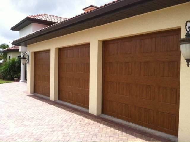Affordable perfection these clopay gallery collection for Wood look garage doors