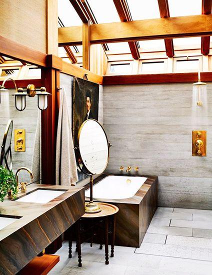 Tour the Ultimate Designer Dream Home// stone bathroom, open shower, soaking tub, skylight