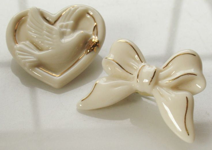 2 doves vintage brooches made