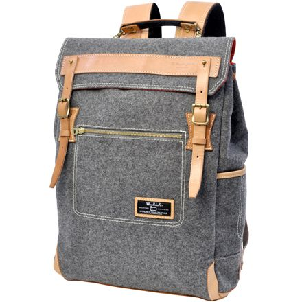perfect backpack for him.   Woolrich / master-piece