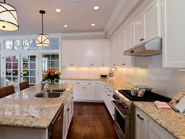 White Kitchen with White Marble Countertops and Island Seating