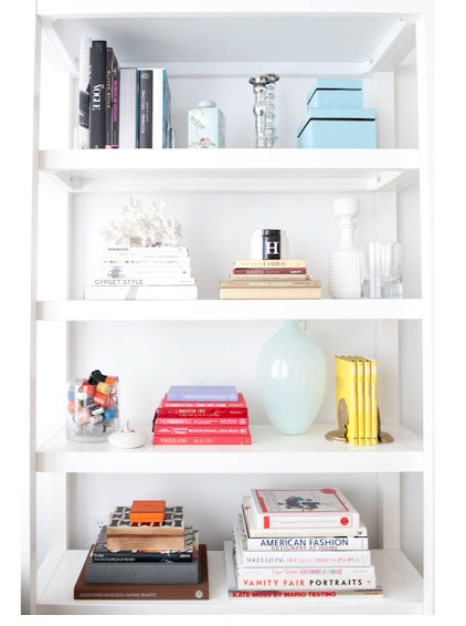 Organizing Your Library- Strike a balance between adding decorative touches and just cluttering your bookshelves- image via The Coveteur