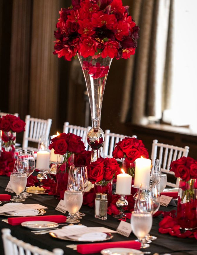 We love the drama of red flowers at a wedding! Combine with black and white decor for a super classic look. #redweddings
