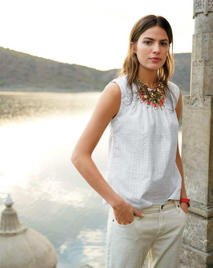 J.Crew women's embroidered windowpane top and wildflower necklace.
