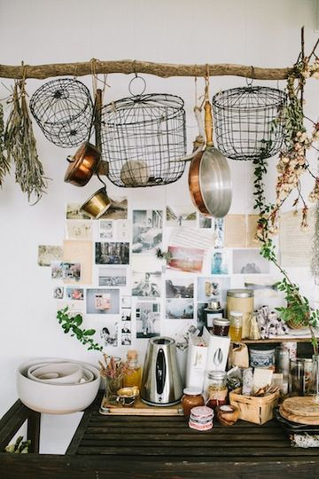 Wire storage baskets hanging on a branch, drying flowers and herbs, coffee/tea bar and photos!
