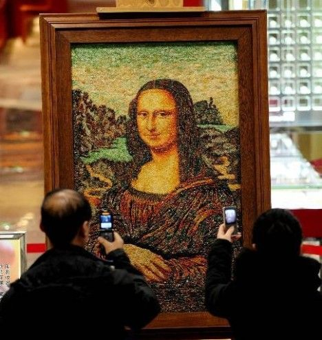 """Mona Lisa made of 100,000 carats of jewelry.  A Chinese jewelry collector has created a replica of Leonardo da Vinci's ""Mona Lisa"" with 100,000 carats of jewelry.    He has spent the last five years working on this one-of-a-kind jewelry painting and the last 30 years collecting all the necessary raw gem stones.    This bedazzled replica of the Mona Lisa is currently on display in a shopping mall in Shenyang City, China.""  Speechless."