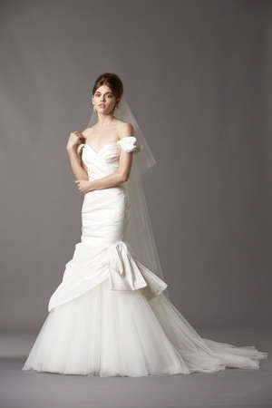 An incredible off the shoulder wedding dress made with
