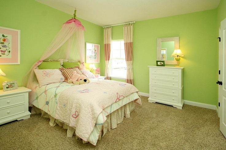 Cute green kid's room with flower canopy...great for a girl's room.