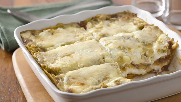 layered tortilla, pulled pork casserole rich with green chile ...