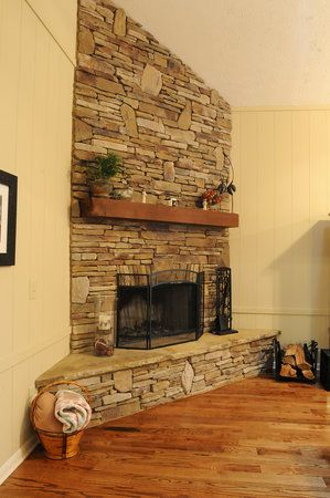 Stacked stone corner fireplace a new house great room for Corner stone fireplace