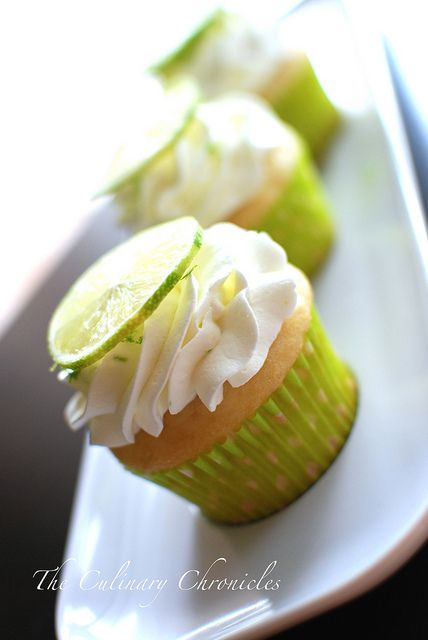sweet mother of pearl... fluffy lime cupcakes with lime whipped cream.  after i try lime sugar cookies, these are on next on the list.