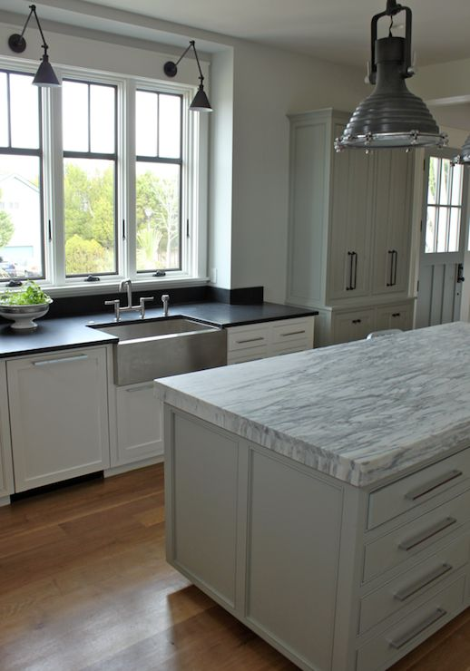 faucet Kitchen features gray pantry cabinets with bronze hardware