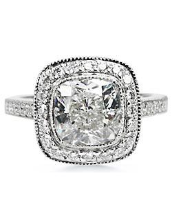 Diamond Ideals: 2.5CT cusion bezel set diamond w/ total .05-CT round side diamonds