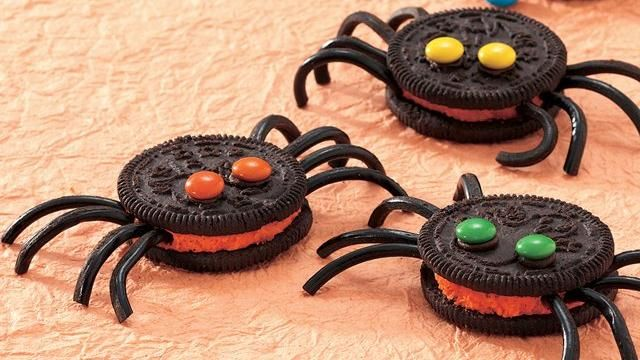"These creepy-crawlers, made with filled cookies, candies, and ready-made frosting ""glue"", are perfect for a Halloween gathering."
