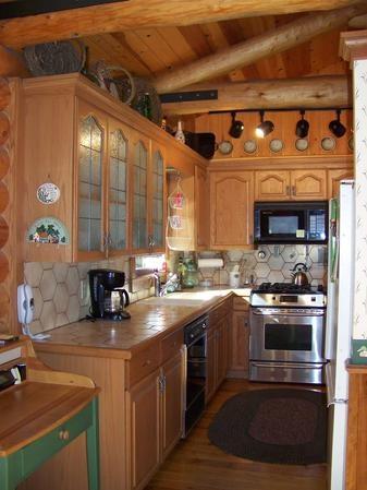 Small but cute log cabin kitchen beautiful houses rooms for Small log cabin kitchens