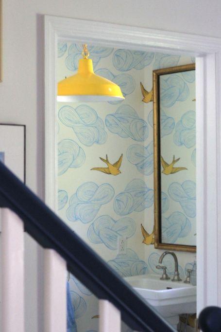 wallpapered bathroom vintage gold frame mirror blue penny tile floor