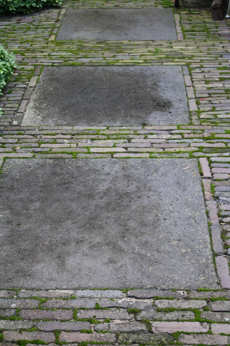 What a way to garden thin gray stones bricks or cobble for Grey stones for landscaping