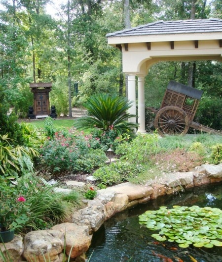 Pond with gazebo type structure. Hey Pinterest