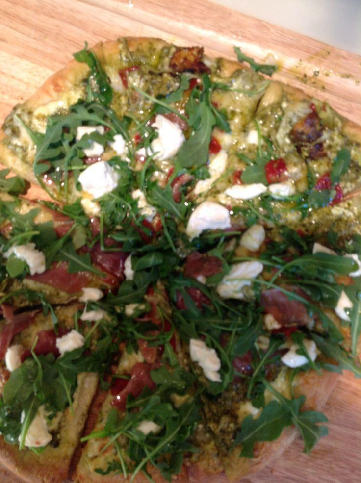Home made pizza with ricotta, mozzarella, pesto, roasted red pepper ...