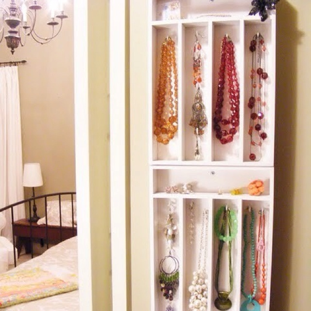 Mount silverware holders on the wall and use for jewelry