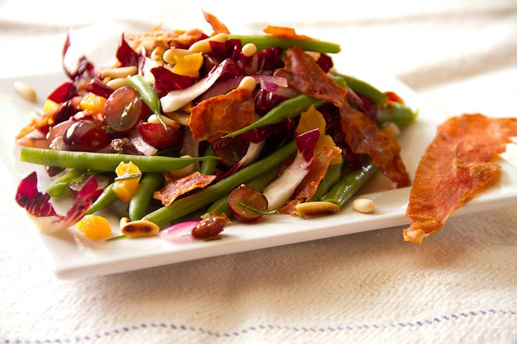 Sicilian salad with dried fruit and fried rosemary