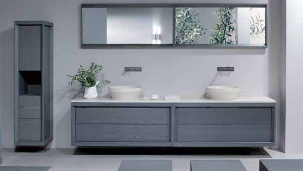 Dogi bathroom by GD Cucine - Baltic grey ash-wood vanity. Honed Biancone stone countertop and washbasin.