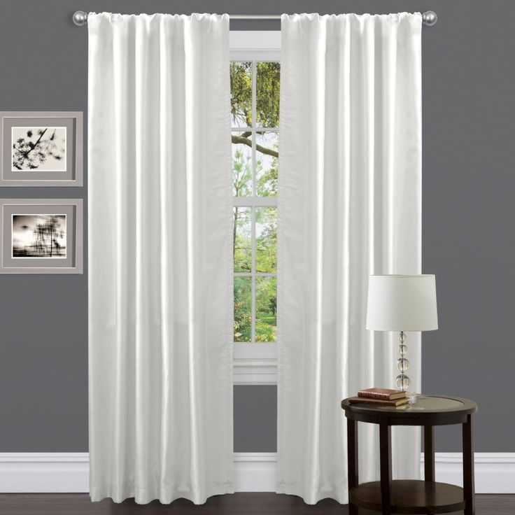 This Venetian fax white curtain panel gives any window a clean and ...
