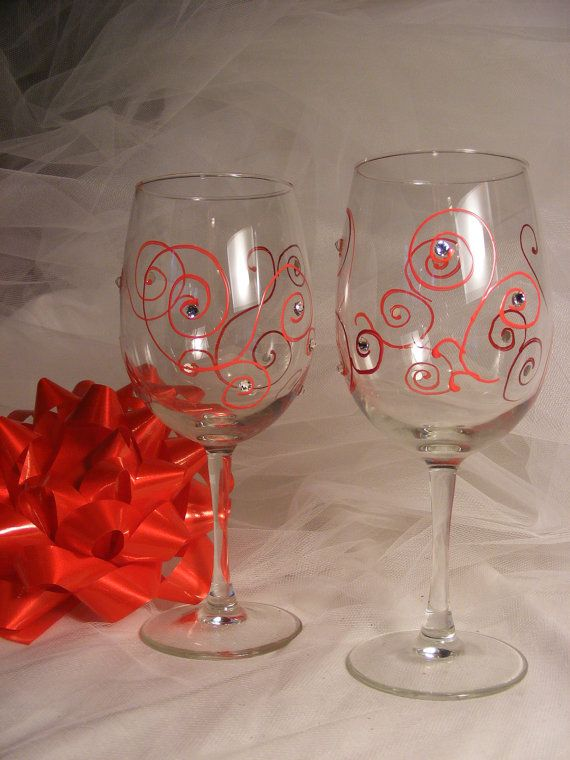 Hand painted christmas wine glasses with red swirls and for Hand painted wine glass christmas designs