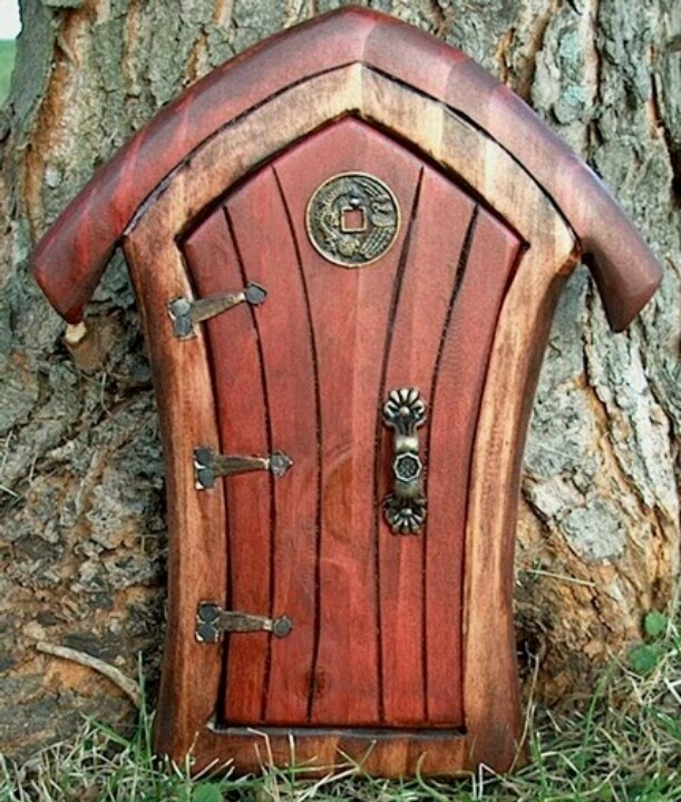 Hobbit door places pinterest for Wooden fairy doors